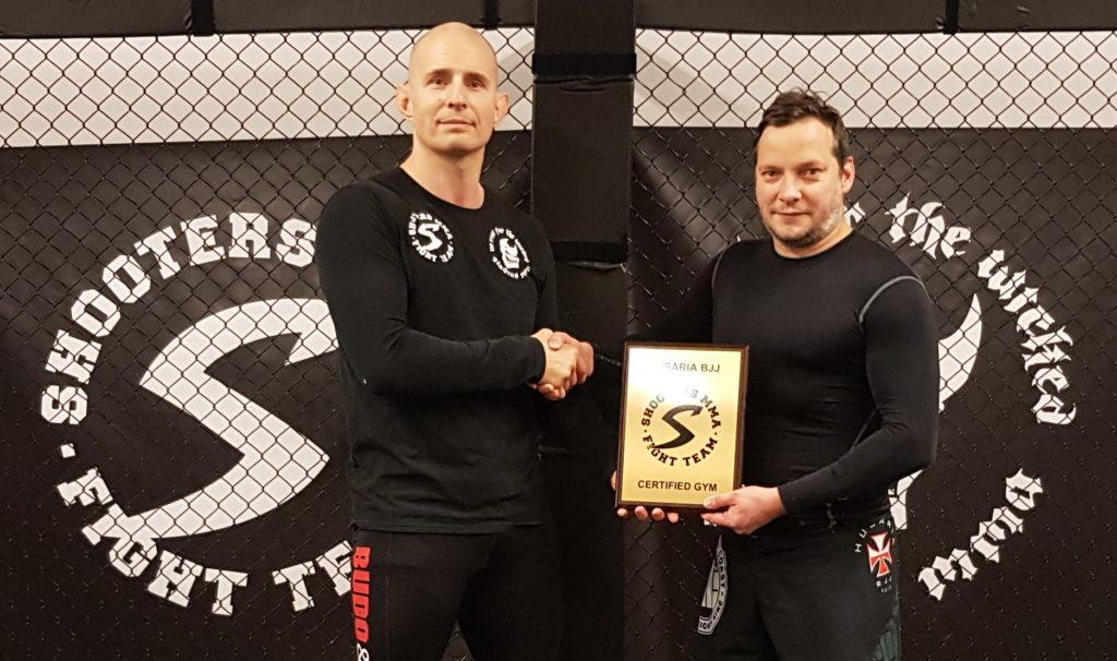 Pawel Harasim receives the affiliation plaque