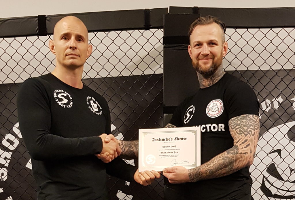 Christian Smith receives the full Shooters MMA instructor's license