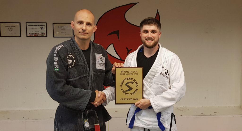 Patrick Mckinnon receives the affiliation plaque